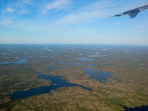 The view from the plane as we left Yellowknife. The area is starting to warm to the north. (Photo credit: John Kelly)