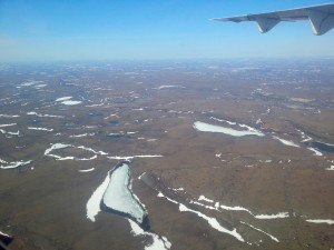 The view from the plane as we get closer to Kugluktuk. These lakes are still covered in ice while the lakes to the south have already thawed for the season. (Photo credit: John Kelly)