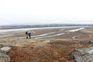 Researchers Greg Lehn and Rob Macdonald look out at the delta of the Coppermine River from the bluffs above. (Photo credit: John Kelly)