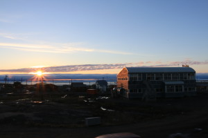 The view of the sunset from Enokhuk Inn. The clouds on the horizon present the closest thing to the actual horizon during the summer months where the sun never completely sets in the Arctic. (Photo credit: John Kelly)