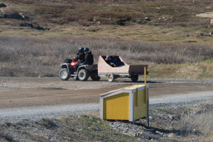 A family takes a trip around town on their quad with a trailer. (Photo credit: John Kelly)