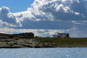 A few small homes on one of the islands in the middle of the Coppermine River estuary. (Photo credit: Robie Macdonald)